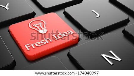 Fresh Idea with Lightbulb Icon - Red Button on Black Computer Keyboard. - stock photo