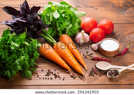Fresh ingredients for cooking on the wood table - stock photo
