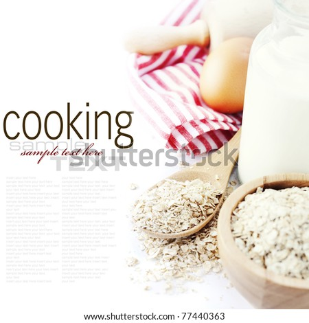 Fresh ingredients for oatmeal cookies (oat flakes, eggs, milk) over white with sample text - stock photo