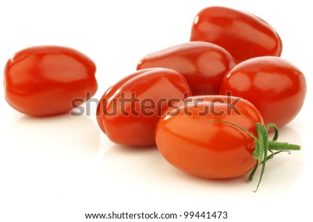 fresh italian pomodori tomatoes on a white background - stock photo