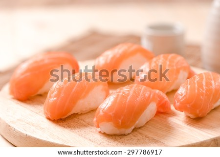 Fresh japanese salmon sushi on wood table - stock photo