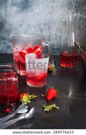 Fresh juice, cocktail or beverage on dark background. See series. - stock photo