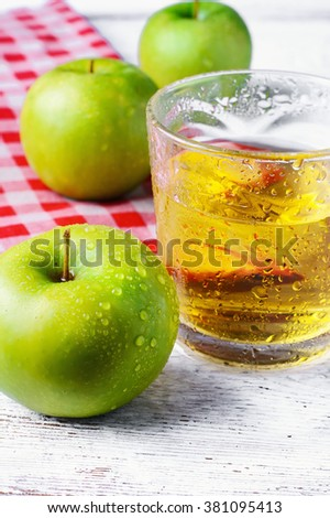 Fresh juice from the fruit green apple on a light background - stock photo