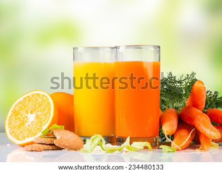 Fresh juice,Healthy drink on white table with nature green background - stock photo
