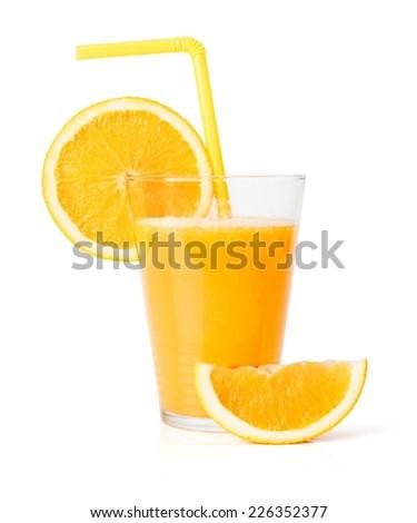 Fresh juice in glass with orange slice and straw - stock photo