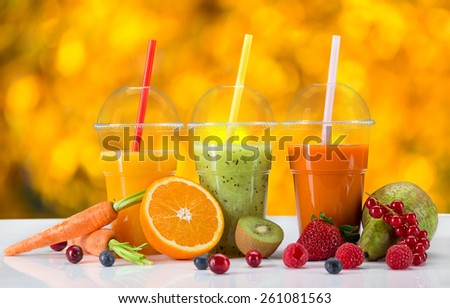 Fresh juice mix vegetables and fruit, healthy drinks on white table. - stock photo