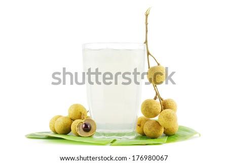 Fresh juice of longan fruits on on white - stock photo