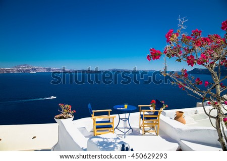 Fresh juice on the table against the blue sea on Santorini. Greece. - stock photo