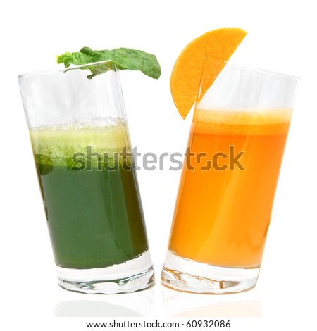 fresh juices from carrot and parsley in glasses isolated on white - stock photo
