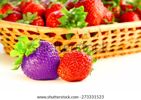 Fresh, juicy and healthy strawberries, red and blue - stock photo