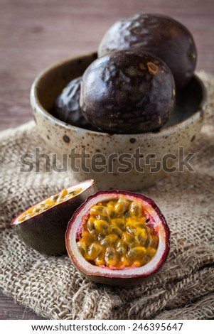 Fresh juicy passion fruit on wooden background - stock photo