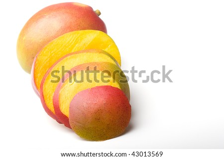 Fresh juicy ripe mango tropical fruit sliced isolated - stock photo