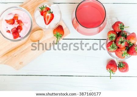 Fresh juicy strawberry: yogurt, juice and fresh strawberry serving on wooden background for summer fresh with copy space - stock photo