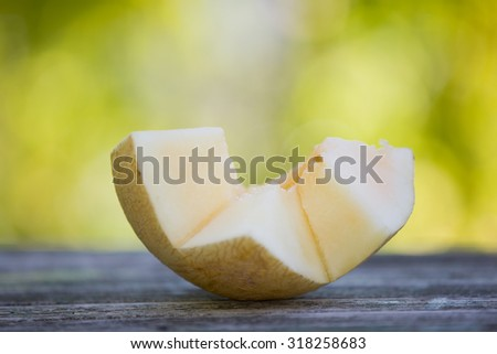 Fresh juicy watermelon against natural green background - stock photo