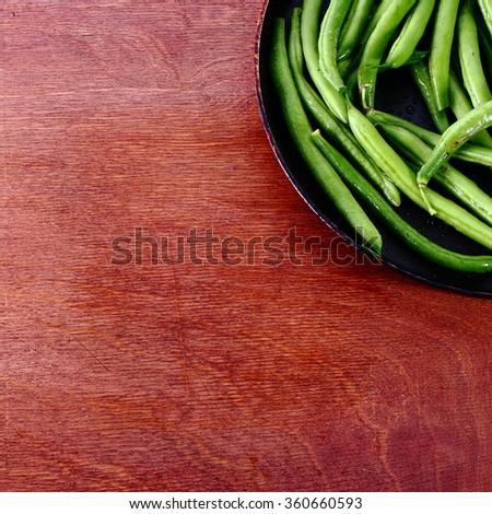 Fresh kidney green bean on wooden table.   - stock photo