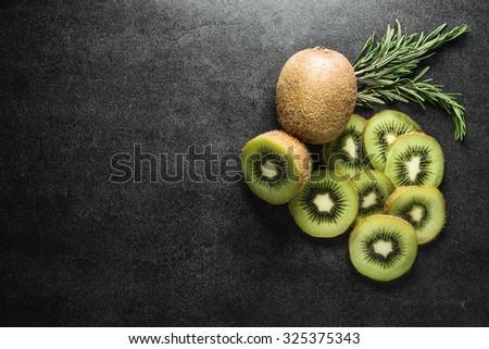 Fresh kiwi on black background. Copy-Space - stock photo