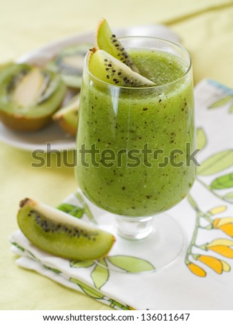 Fresh kiwi smoothie in glass, selective focus - stock photo