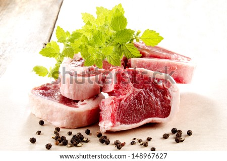 fresh lamb chops with organic mint and peppercorn - stock photo