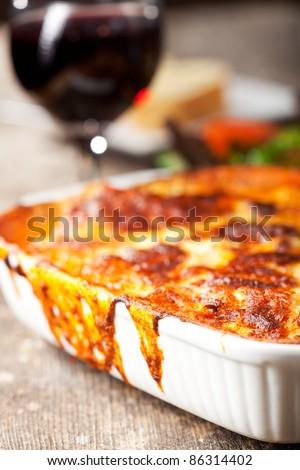 fresh lasagna dish in a baking dish - stock photo