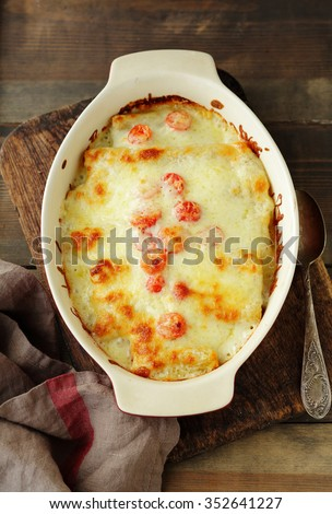 fresh lasagna in baking dish, top view - stock photo