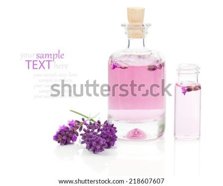 fresh lavender blossoms with Natural handmade lavender oil, on white background - stock photo