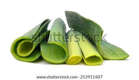 fresh leeks sliced isolated on white - stock photo
