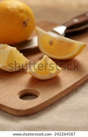 Fresh lemon on a cutting board. - stock photo