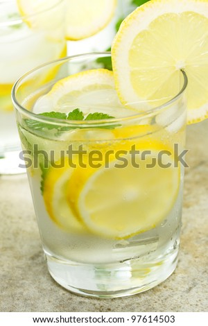 Fresh Lemonade in a Glass with Lemon Slices - stock photo
