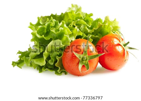 fresh lettuces salad with fresh two tomatoes isolated on white background - stock photo