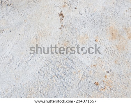 fresh light gray cement floor with a rough and uneven surface traces  - stock photo