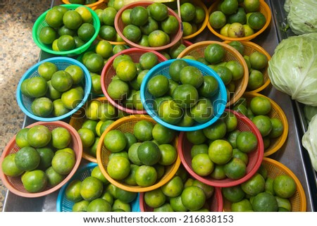 Fresh lime on sale in market - stock photo