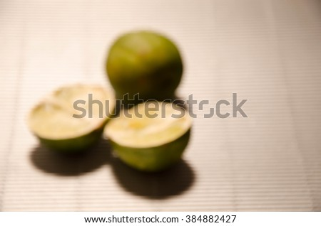 fresh lime wedge isolated on a white background. - stock photo