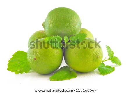 Fresh lime with lemon mint on a white background - stock photo