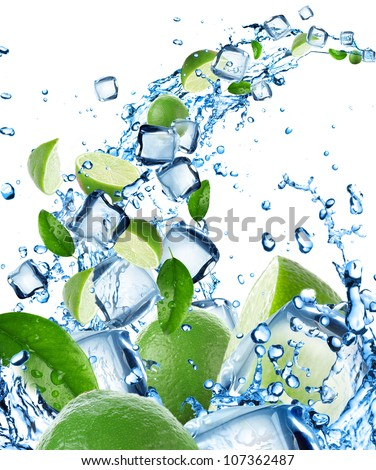 Fresh limes in water splash with ice cubes - stock photo