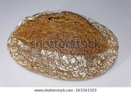 Fresh loaf of traditional bread (recipe from1925) over gray background. Close-up. Shallow depth of field.                        - stock photo
