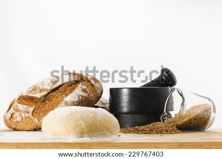 Fresh loaf of whole wheat sourdough bread dough rising on a bakers work table - stock photo