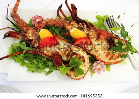 Fresh lobster served at a seafood restaurant - stock photo