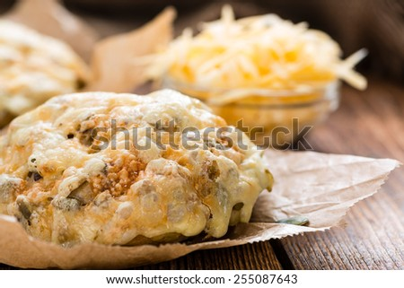 Fresh made Cheese Bun (on an old rustic table) - stock photo