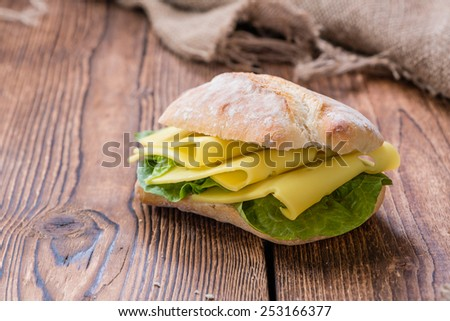 Fresh made Cheese Sandwich on an old rustic wooden table - stock photo