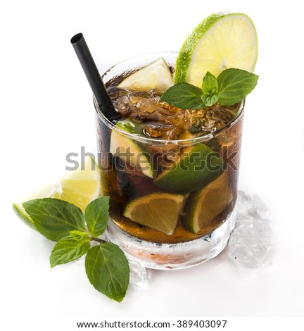 Fresh made Cuba Libre (isolated on white background) with brown rum and lime - stock photo