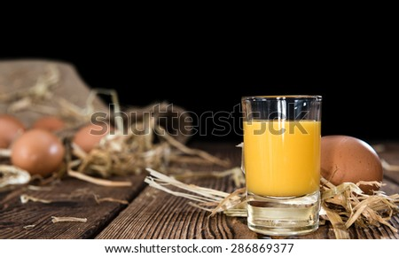 Fresh made Egg Liqueur on vintage wooden background - stock photo