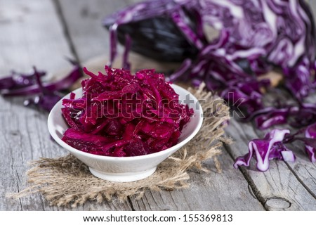 Fresh made portion of red Coleslaw on wooden background - stock photo