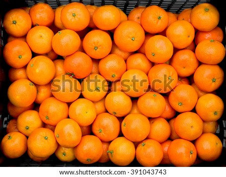 Fresh mandarin oranges in a black box - stock photo