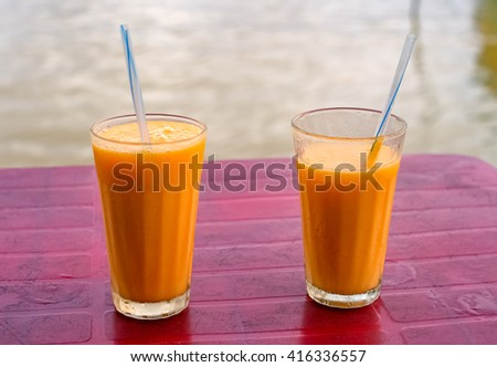 Fresh mango fruit milk shakes close up - stock photo