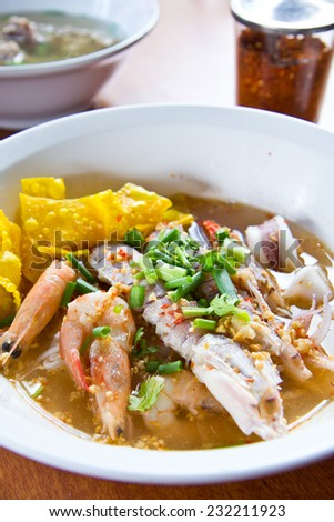 Fresh mantis shrimp and seafood with Tom Yum noodle, Bangkok Thailand - stock photo