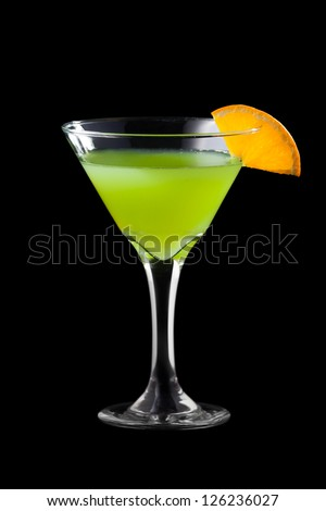 Fresh martini coctail isolated on black background - stock photo