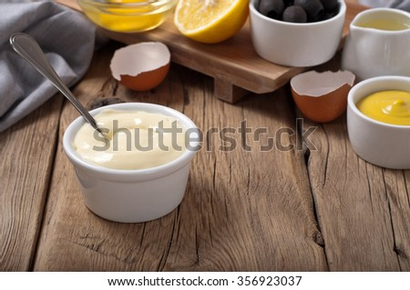 Fresh mayonnaise with ingredients for cooking homemade mayonnaise - stock photo
