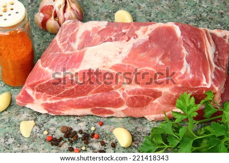 fresh meat : raw  pork with green stuff and spices - stock photo
