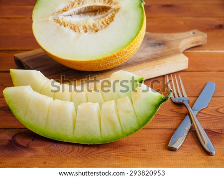 Fresh melon sliced on wooden background. Selective focus, shallow depth of field - stock photo