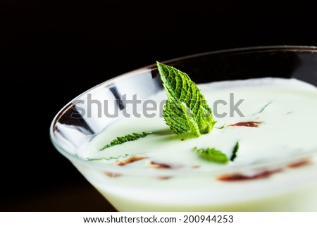 Fresh melon soup with ham on a wooden table. - stock photo